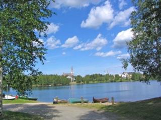 The Lake and Church At Rovariemi